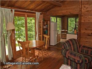 Cedar Log Cottage living room, dining and kitchen