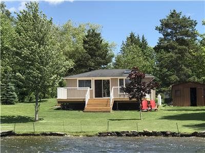 A Quiet Cottage Retreat - Close to City - Beautiful west exposure 100' waterfront