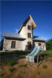 Rosa is Solisterra's Eco straw-bale Cottage located directly on its own beautiful sandy beach