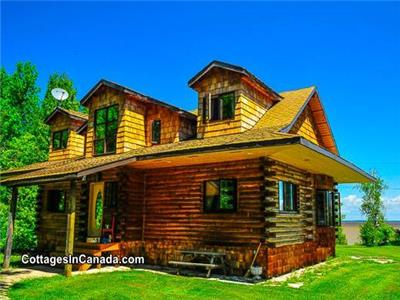 Lakefront Loghouse on 28 acres in Traverse Bay, MB near Victoria Beach with YEAR ROUND HOT TUB