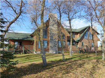 The Chalet Beach Lodge: Exquisite lakefront log home overlooking lake Winnipeg on private 25 acres