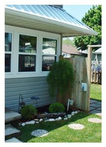 Cozy, Cute, Immaculate Cottage Steps from Main Beach $1100 Friday to Friday rental only.