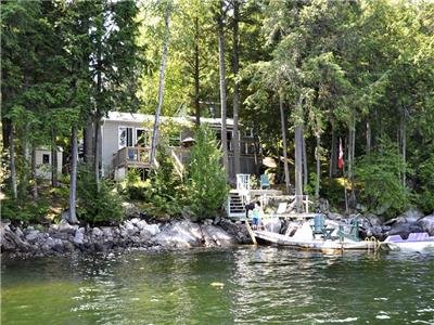 Modern cottage on deep clean lake.