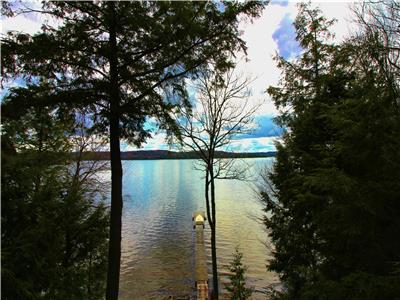 Fabulous sand beach cottage on prestigious Kennisis Lake