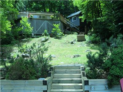 Private, sand beach cottage on prestigious Kennisis Lake