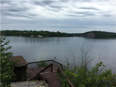 French River, Alban, cottage on double lot, 9 acres with approx 375 feet waterfront best view ever!