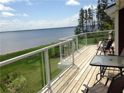 **Waterfront**  Two bedroom upper unit with balcony on Shediac Bay