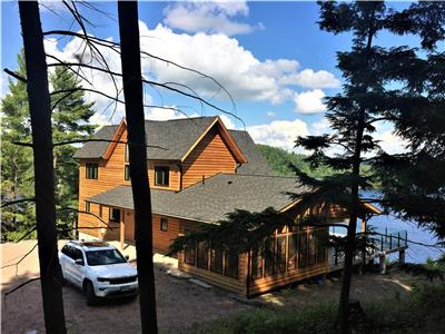 Exquisite Ecolog home on 5.2 acres with panoramic view of Redstone Lake