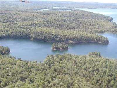 Picturesque PRIVATE Island with 2 Cottages and Income Potential located in Provincial Park