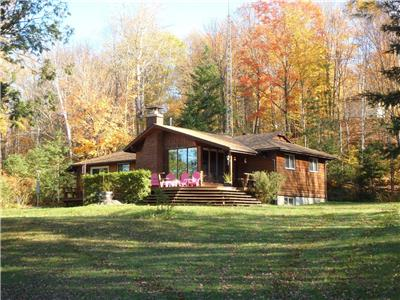 Beautiful 5 Bedroom, 2 Bathroom cottage on Doe Lake with 305 feet of sandy beach South/West frontage