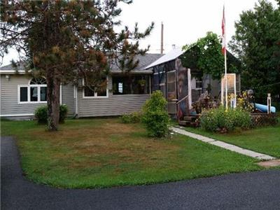 2 or 3 bedroom cottage.  All amenities.  On lakeshore just 5 minutes from wine boutique and shopping
