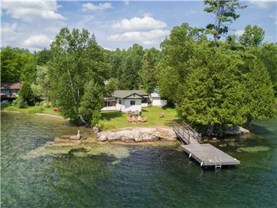 2-Bdr / Crystal clear Lac Paquin with Sandy Beach / Ideal for families.