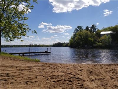 Waterfront cottage with private sand beach in quiet Kawartha setting