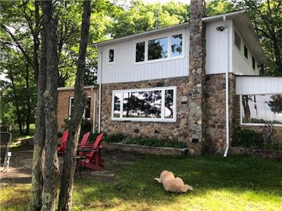 B'Haven Lakehouse - a warmly renovated two story home on 220' sandy shoreline waterfront
