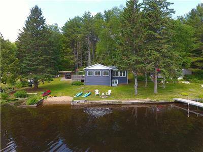 Baptiste Lake Golden Shores with hard sand shoreline **Weekly rentals only until mid September**