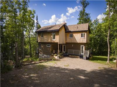 Secluded and airy lake house with private swimming and short walk to sandy beach