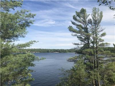 SOLD! Newly & exquisitely renovated water access cottage on Go Home Lake with 180 degree panoramic