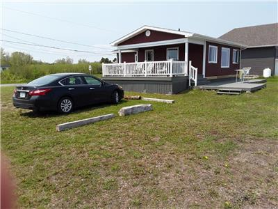 COTTAGE SHOWING PRIDE OF OWNERSHIP ON PRIVATE BEACH, BAY DE CHALEUR