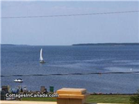 Shediac Area Cottage Rental 100 ft private beach, where you can anchor your watercraft within view